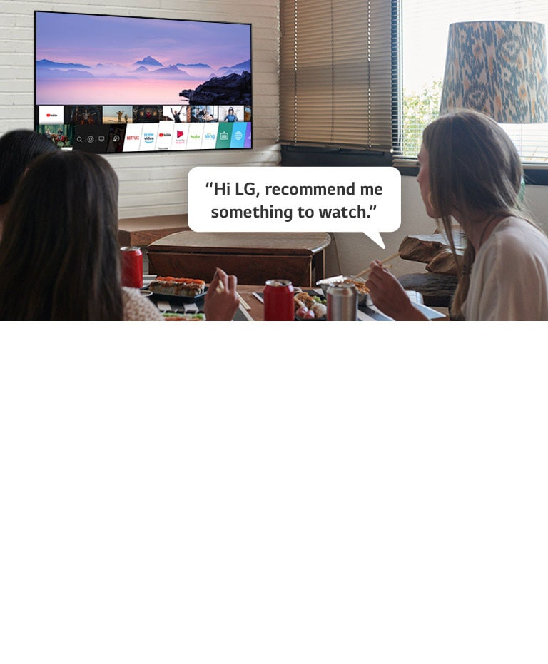 Three woman eating sushi while one of them asks LG TV recommendations to watch