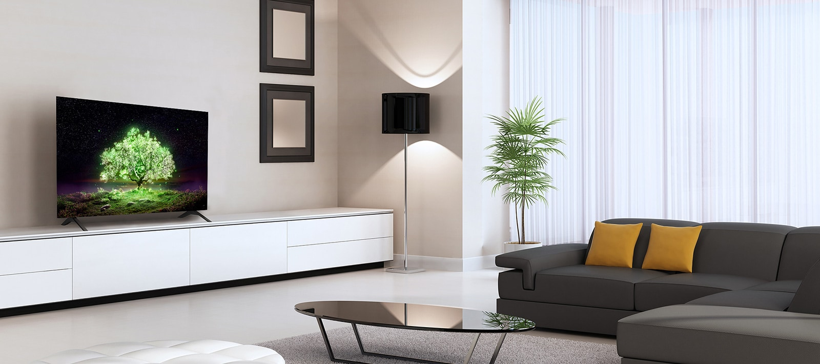 An OLED A1 TV placed in a sensuous living room. On the TV, you can see an image of a brightly glowing green tree.