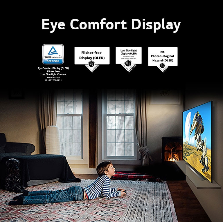 """A side view of a boy laying down and watching a TV, labeled """"Eye Comfort Display"""""""