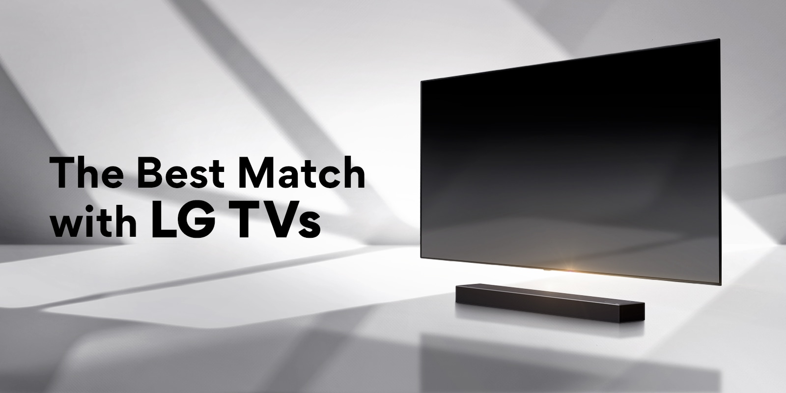 A soundbar and a TV are placed on a white floor and there is a shadow coming from outside right behind.