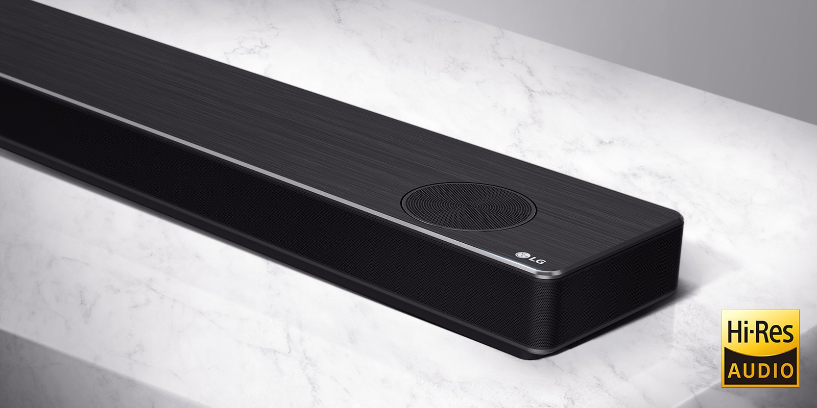 Close-up LG Soundbar right side with LG logo on the bottom right corner of a product.