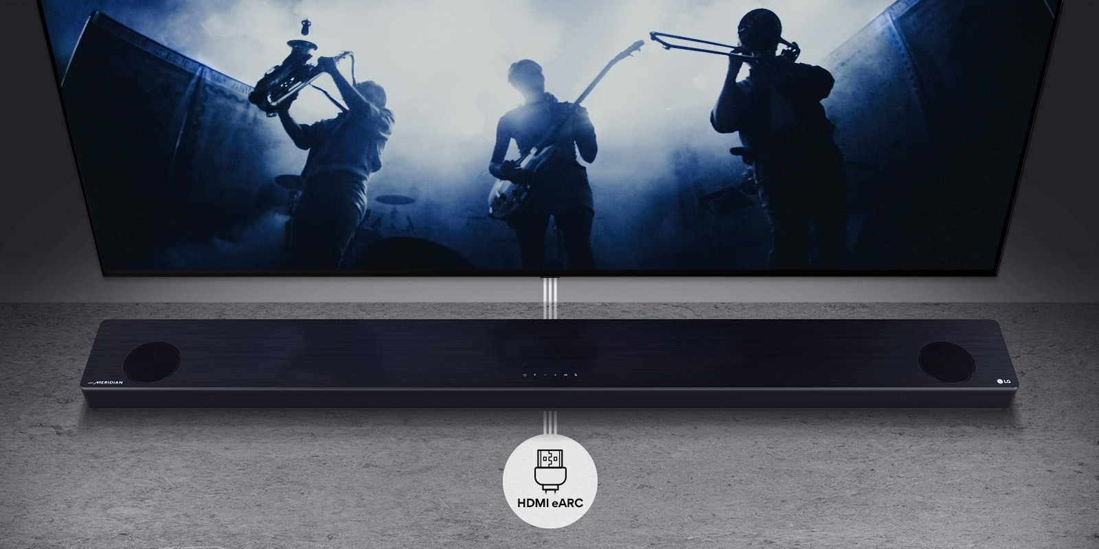 TV is on the wall. TV shows a group of band in black silhouette. LG Soundbar is right below TV on a gray shelf. There is a HDMI eARC icon below the soundbar.