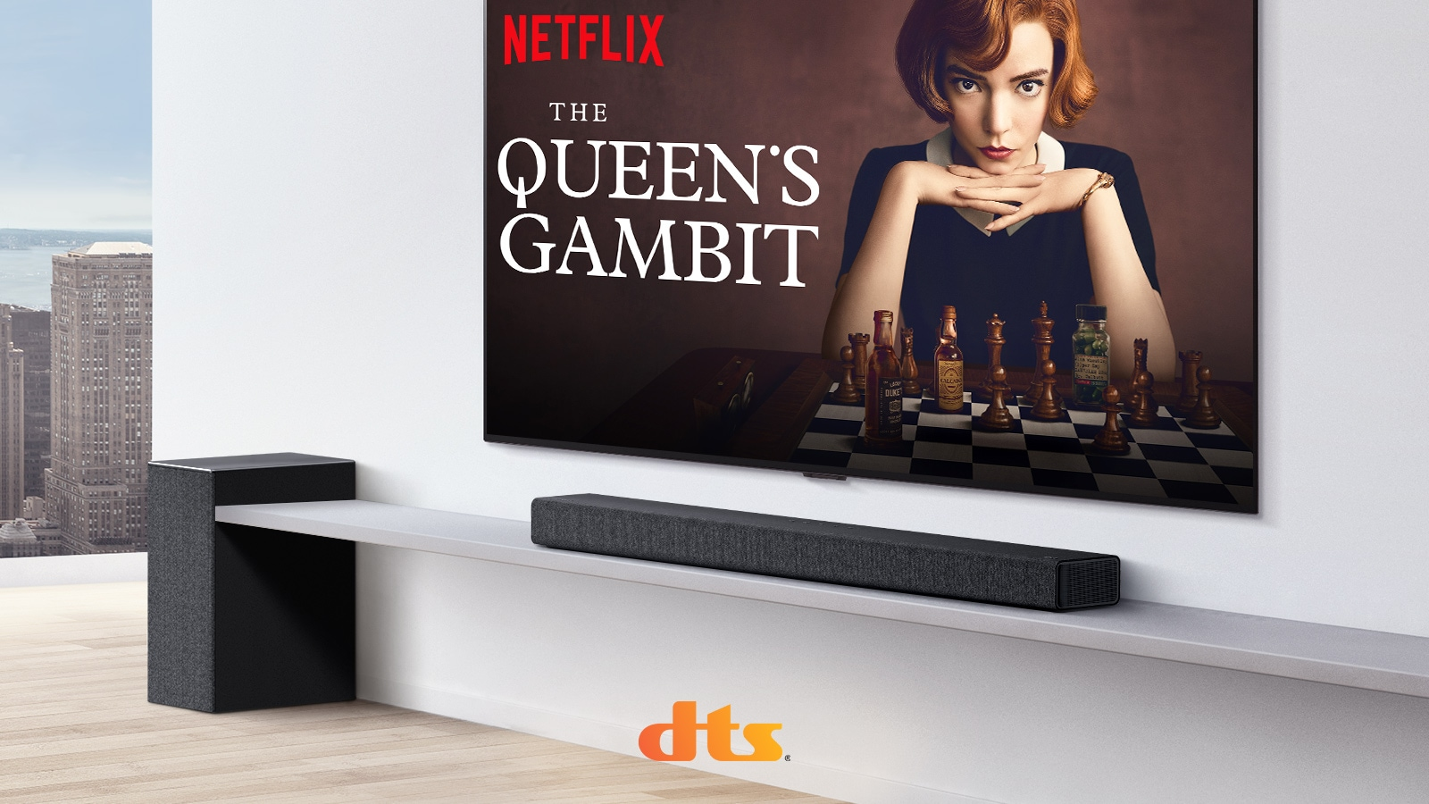 TV is on the wall.  A poster of a TV show is on TV screen. LG Soundbar is right below TV on a white shelf with a sub-woofer right next. Dolby Atmos and DTS:X logo shown on middle bottom of image.