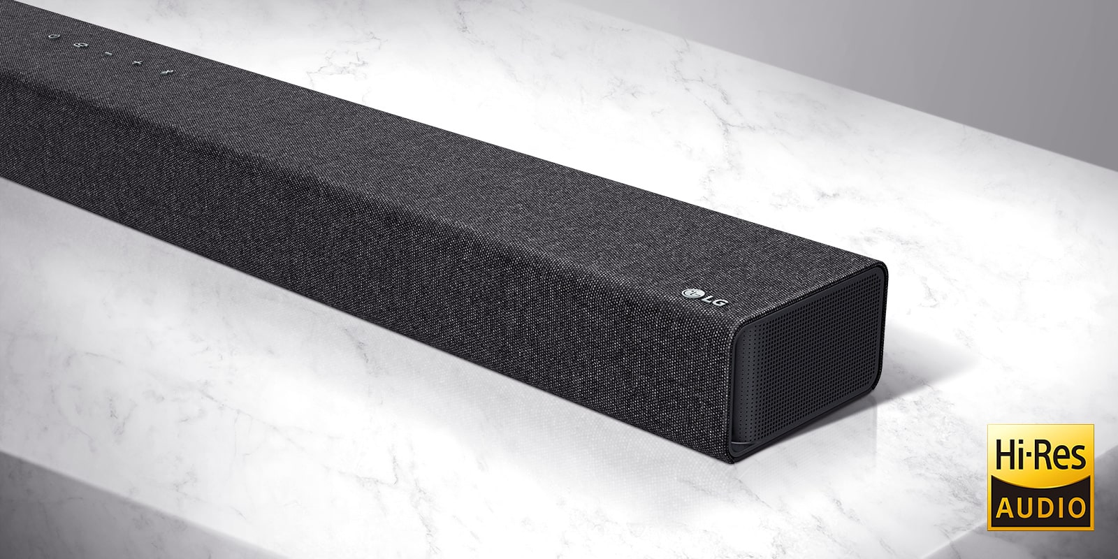 Close-up of LG Soundbar right side with LG logo on the bottom right corner of a product.