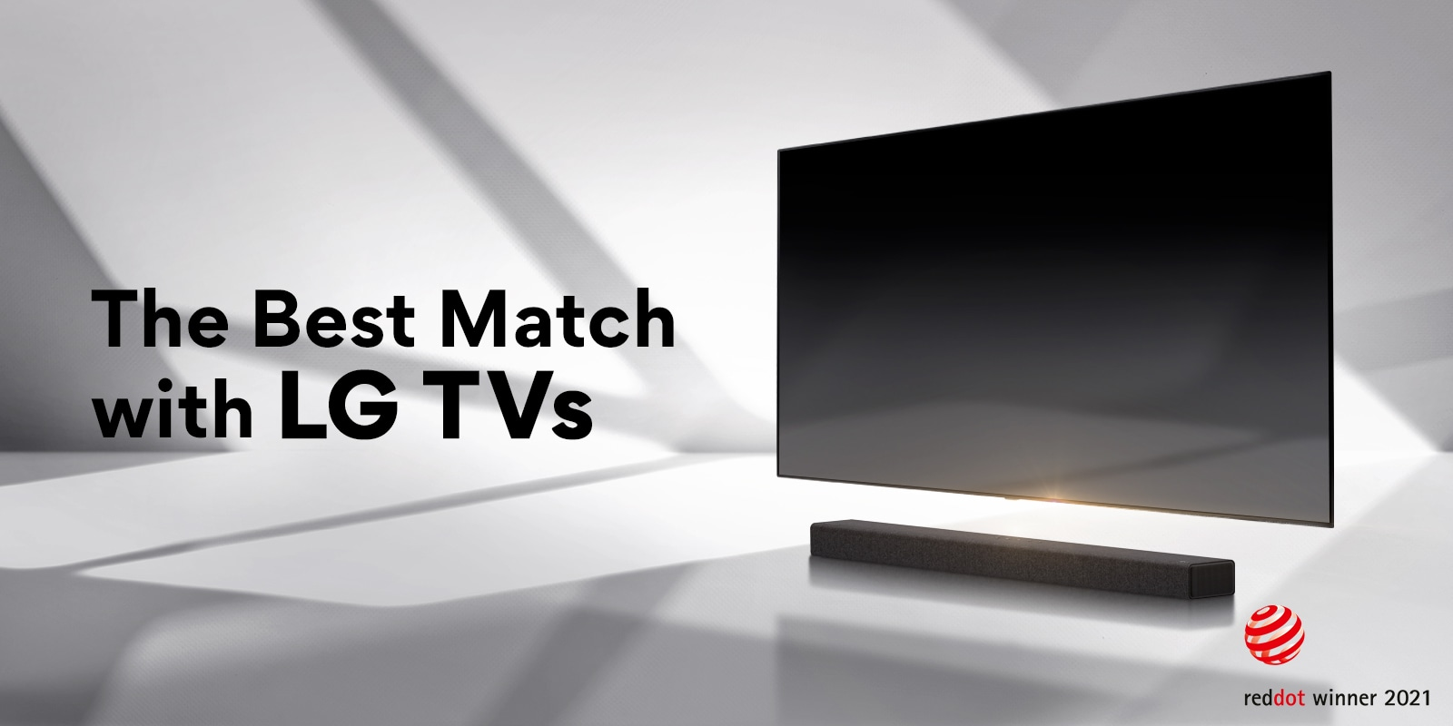 A soundbar and a TV are placed on a white floor and there is a shadow coming from outside right behind. Reddot award logo is placed right next to soundbar.