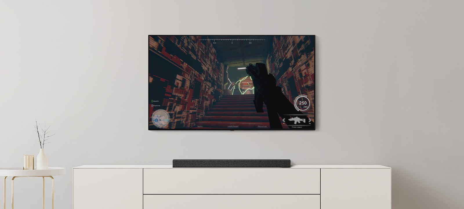There is TV and Soundbar in a living room. An FPS game is on a TV screen and the TV channel is switched to soccer game. (play the video)