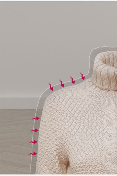 中間下處有線條的展示毛衣。左側標示為「傳統乾衣/高溫烘乾」,而右側標示為「LG Dual Heat Pump™ 溫和除濕式乾衣」。左側的毛衣會縮水,而右側的毛衣會維持原形以及柔軟度。