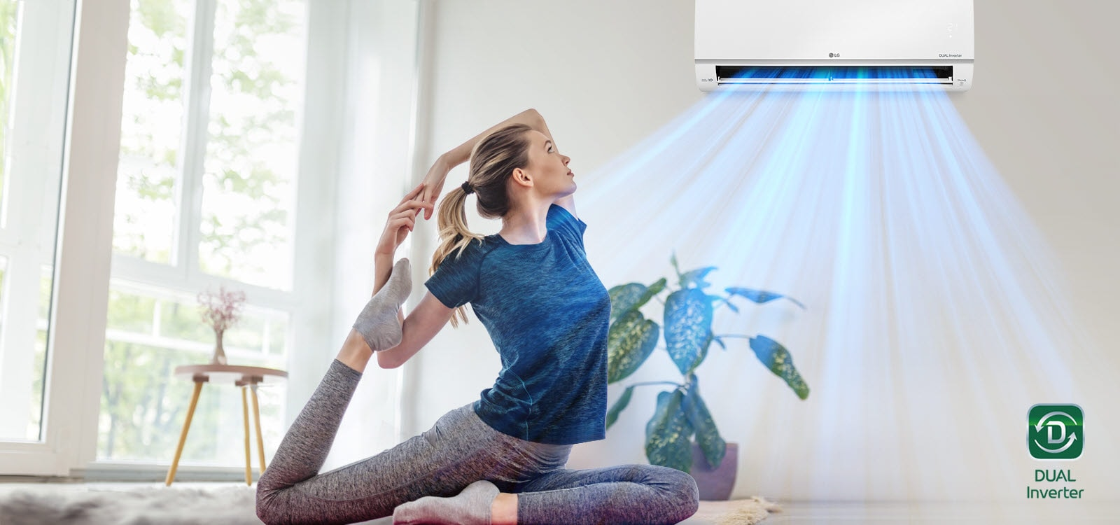 A woman is stretching on the floor. In the background is the air conditioner and blue air flows out over the woman and the room. The Dual Inverter logo is in the bottom right corner.