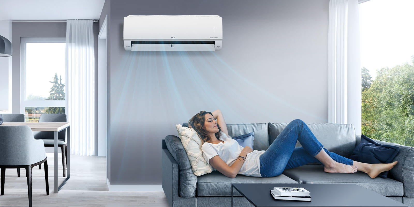 A woman lounges on a couch in a living room with the LG air conditioner installed above her on the wall. Blue streams of air are on the image to indicate it is on and cooling the room.