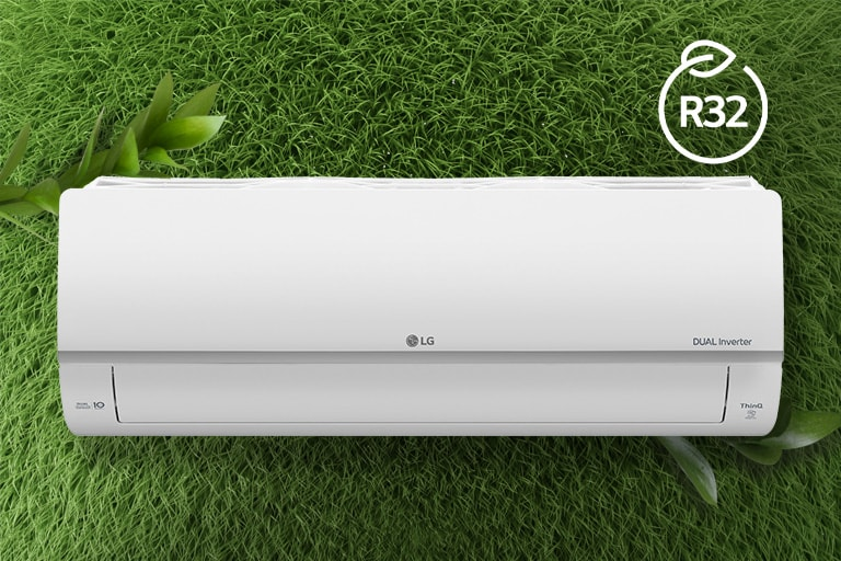 The LG Air conditioner is installed on a wall of grass. The R32 logo for energy efficiency is in the upper right corner.