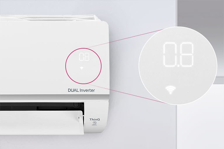 Half of the LG air conditioner can be seen installed on the wall with the front door open indicating it's on. A circle is around the air quality lights of the machine and a magnified circle is extened out to show the green lights of the air quality panel and the numbers to show the precise air quality. The DUAL Inverter logo can be seen on the machine.