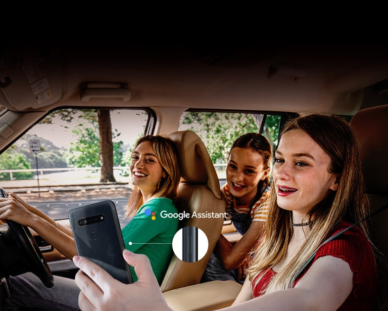 Woman searching with her smartphone in the car using google assistant function