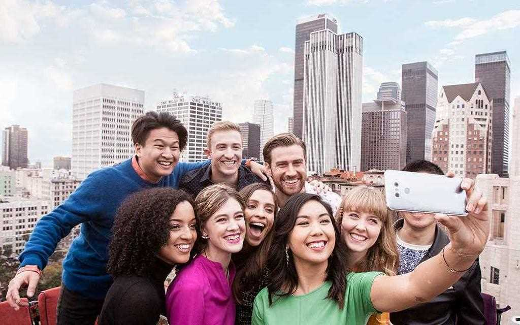 An image of group of taking selfie with new lg g6 smartphone camera