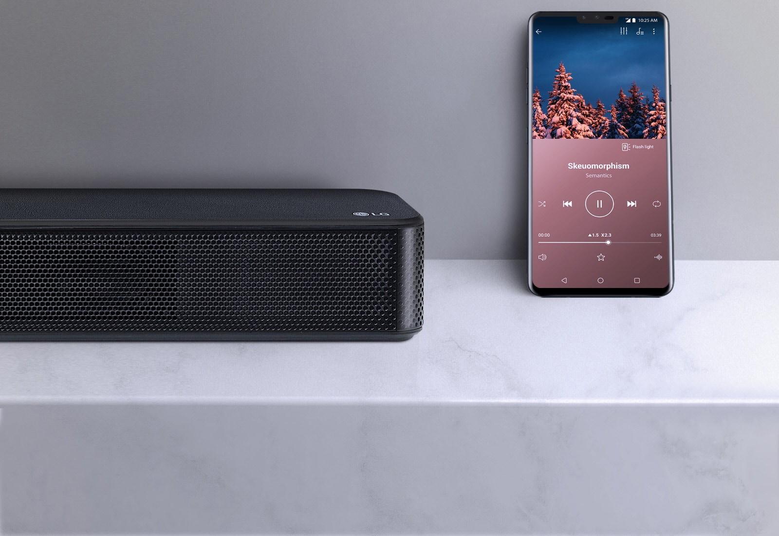 SL5Y Going Wireless Is Effortless - soundbar next a smart phone