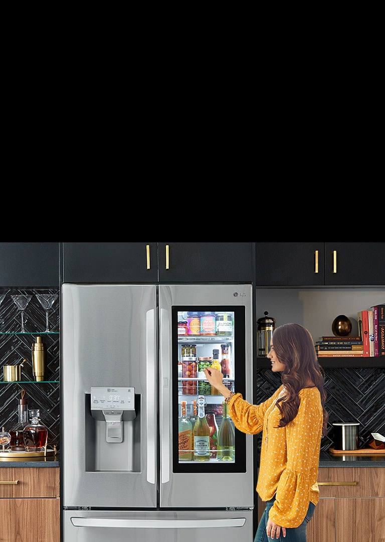 A woman knocking on the window of the LG InstaView Refrigerator