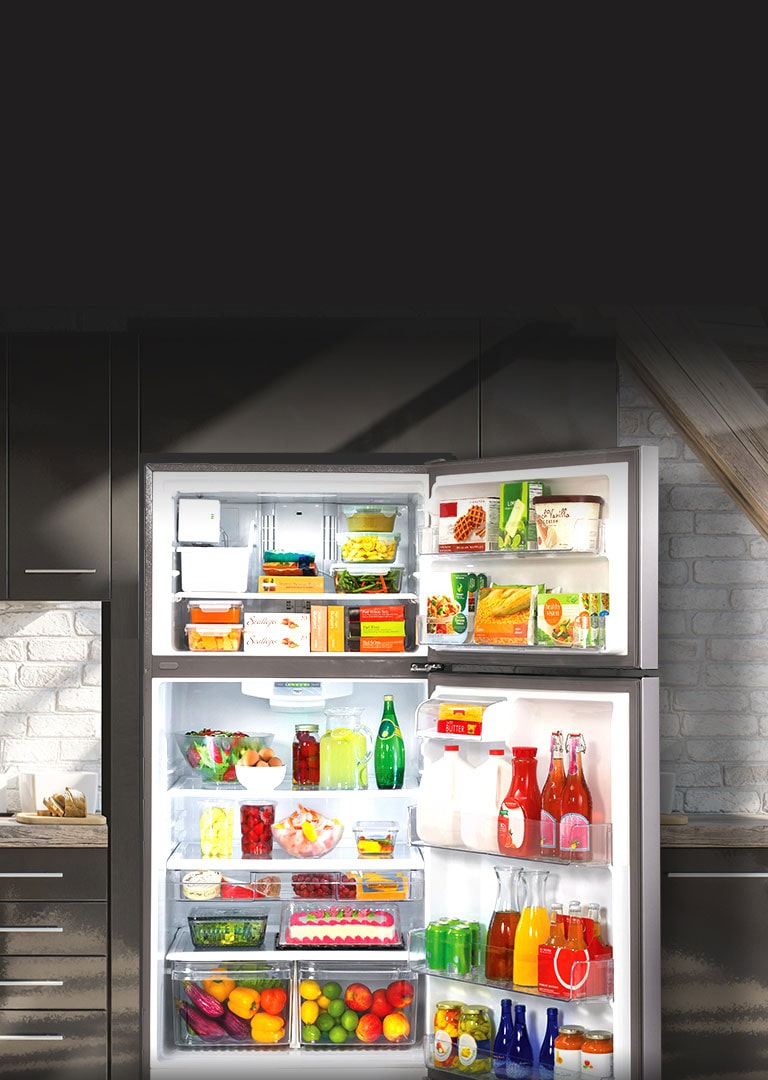 Open LG Refrigerator filled with food highlighted by sunlight in a kitchen