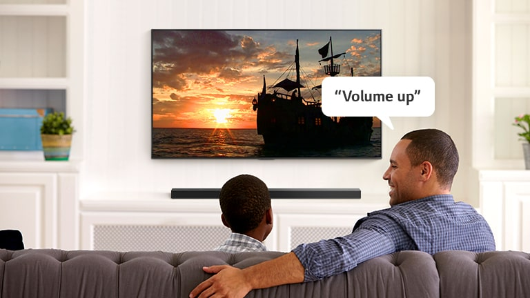 """A man asking TV, """"Volume up"""" to hear louder"""
