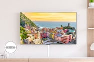 Luxury living room view of LG TV with village landscape on screen