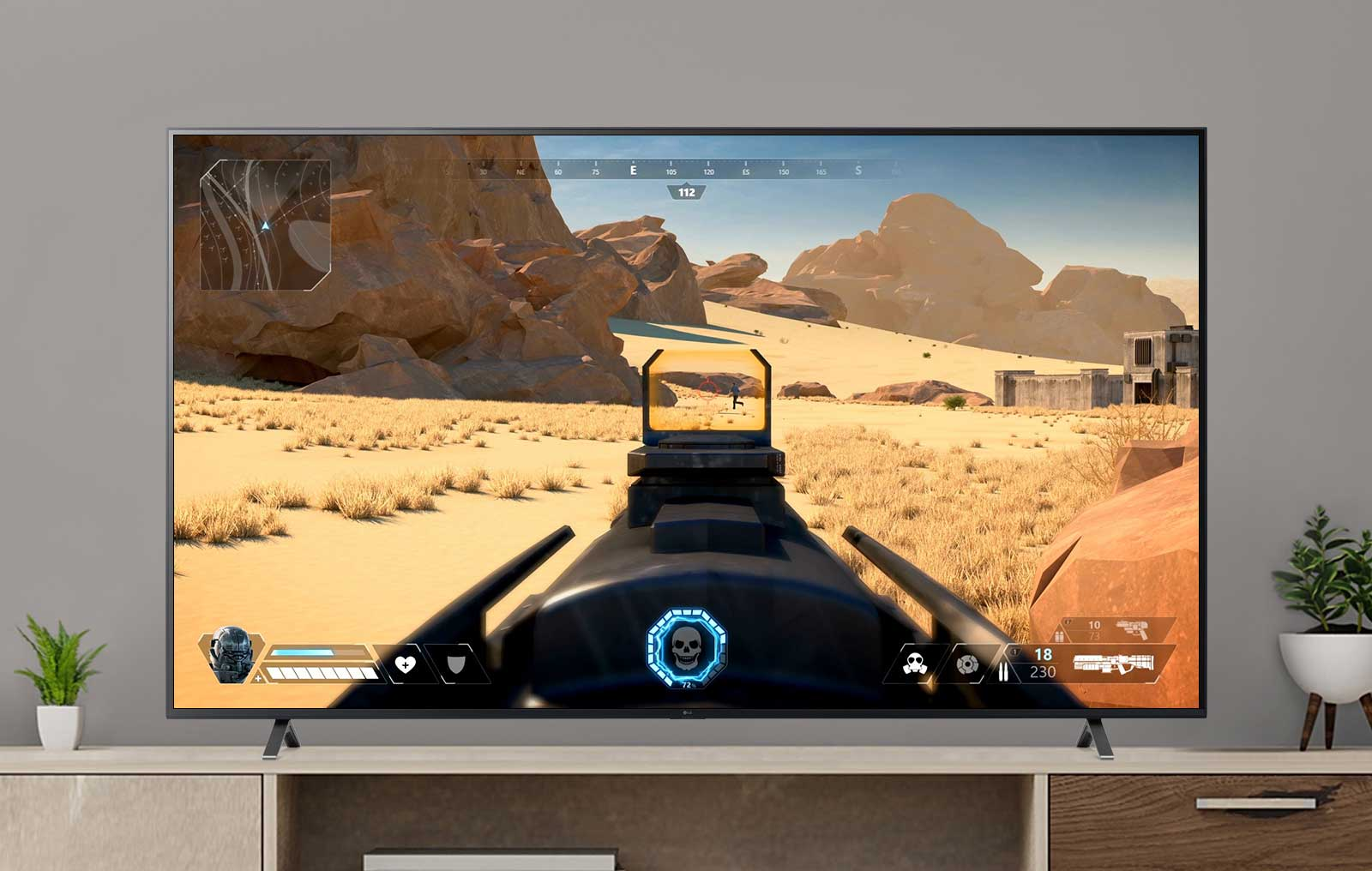 A TV screen playing a video of a FPS game shooting an enemy with a gun. (play the video)