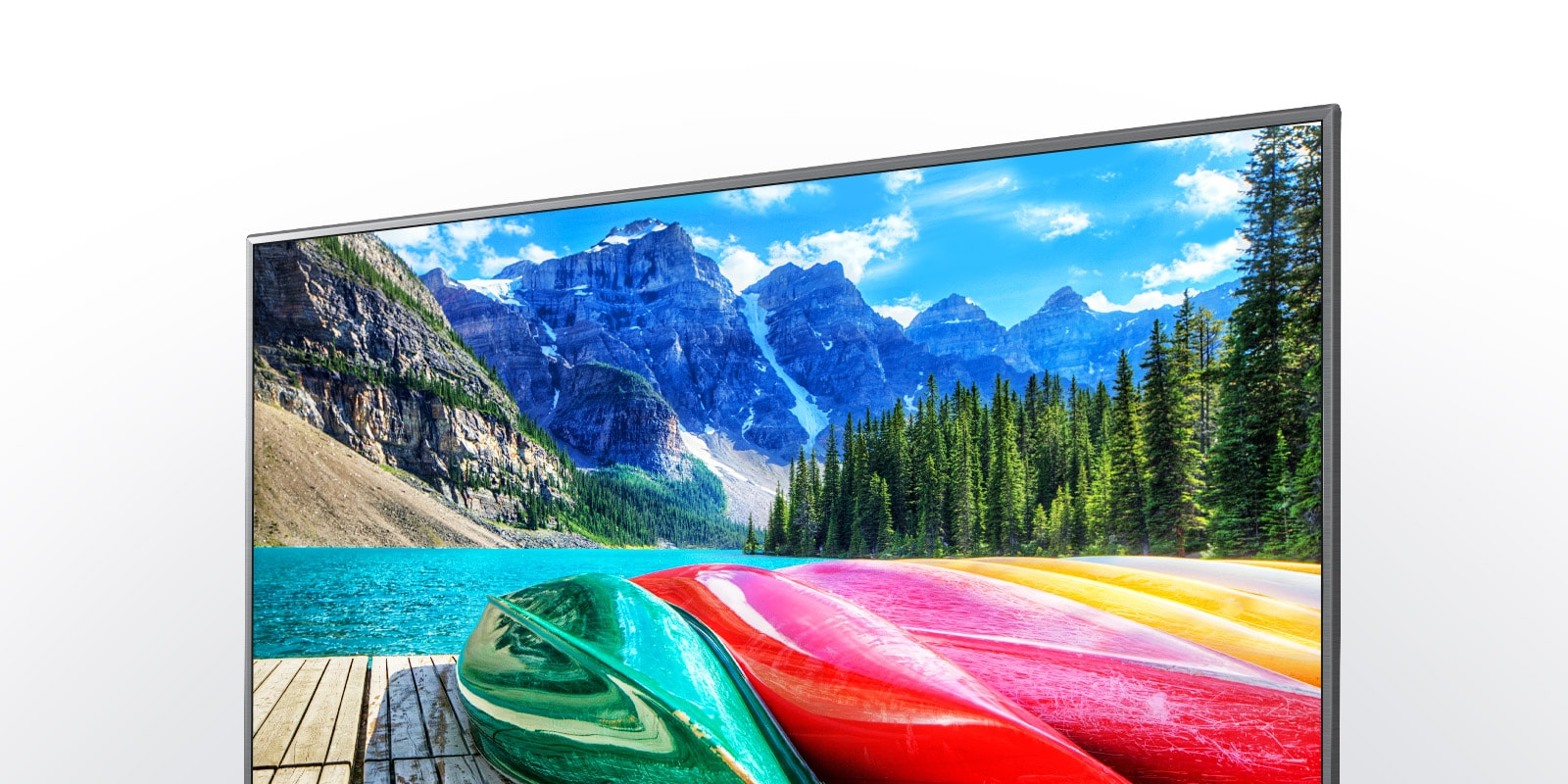 tv with image of boats, river, and mountain in the background