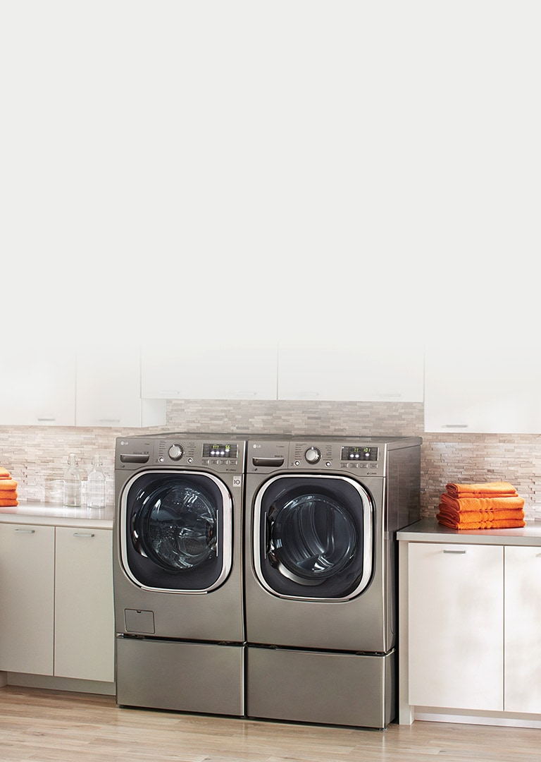Modern laundry room featuring a number of stainless steel LG laundry appliances.