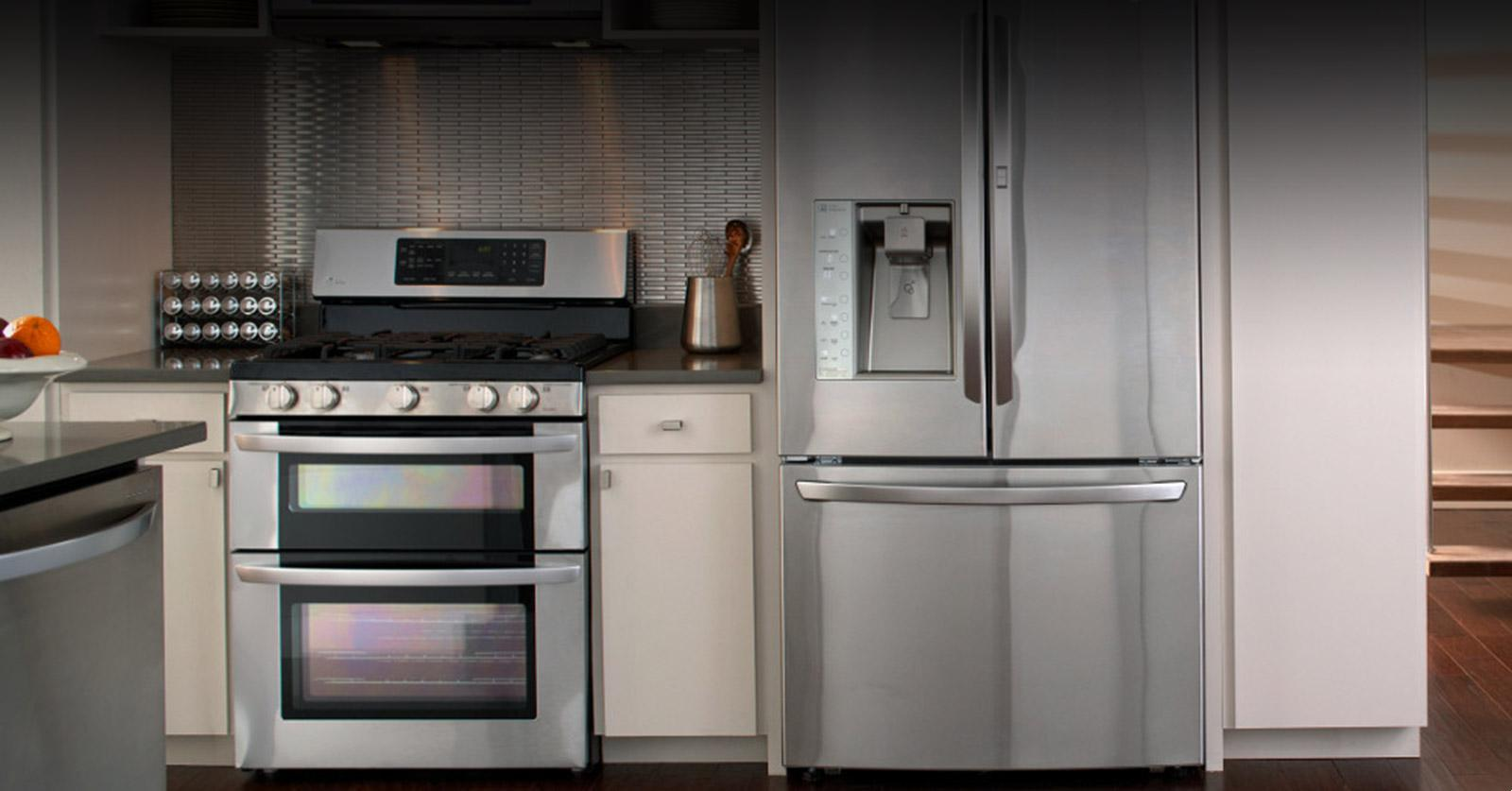 wonderful Lg Kitchen Appliance Reviews #9: Front view of an LG refrigerator and an LG oven.
