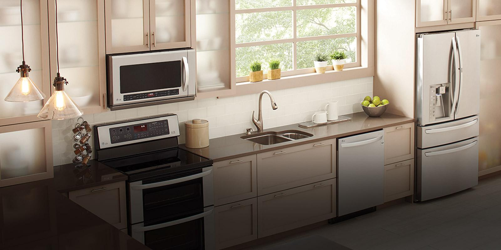 Bright, Modern Kitchen Featuring An LG Over The Range Microwave Oven.