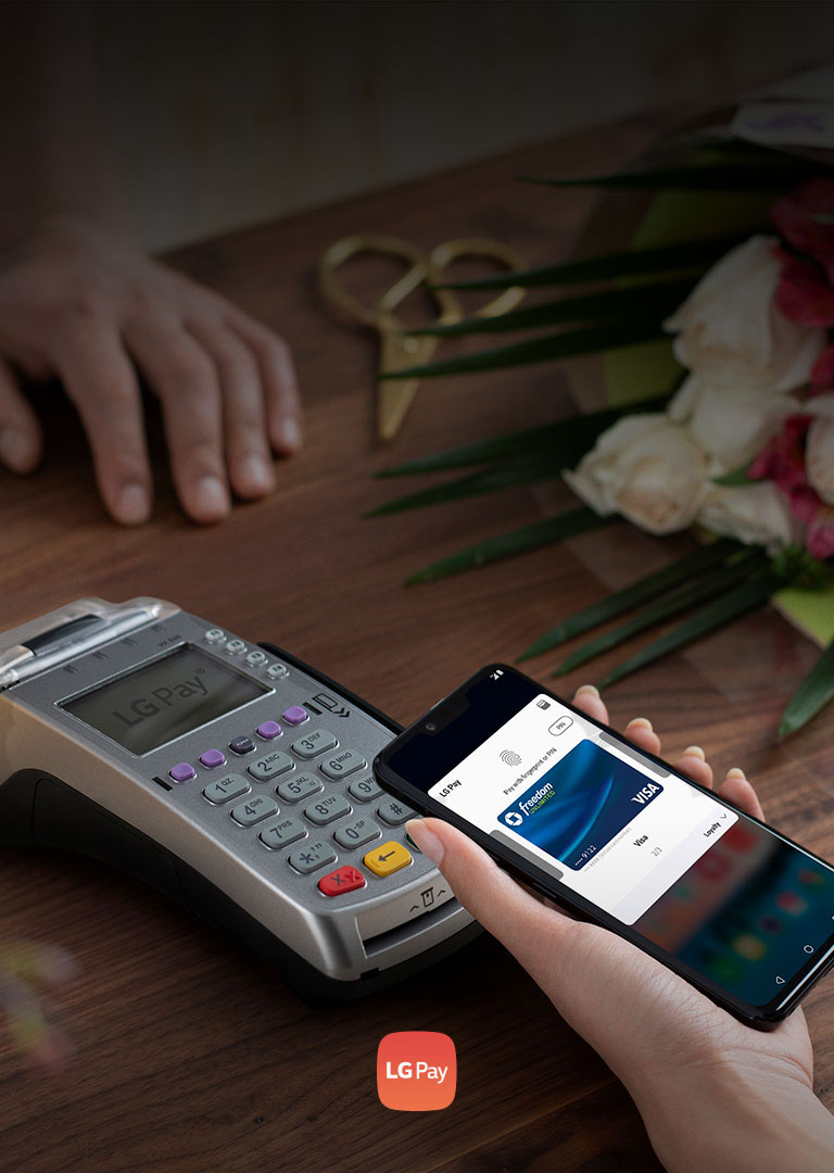 Image of hand holding phone using the LG Pay feature
