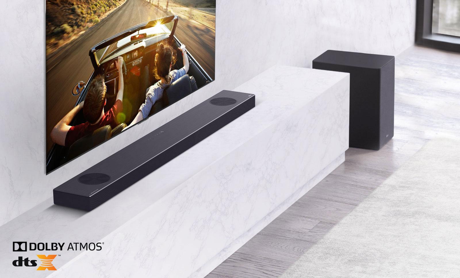 Left side of sound bar and subwoofer, TV on the livingroom