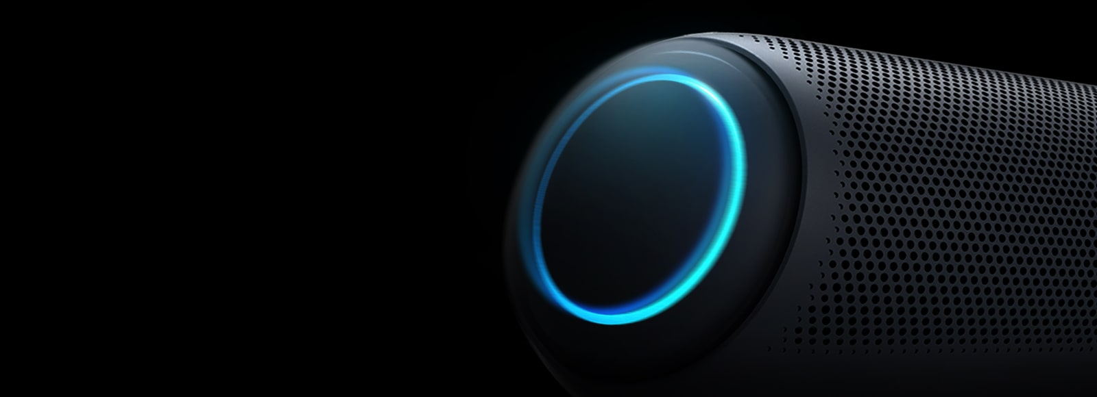 On a black background, There is a close-up of LG XBOOM Go's left woofer with sky-blue lighting.