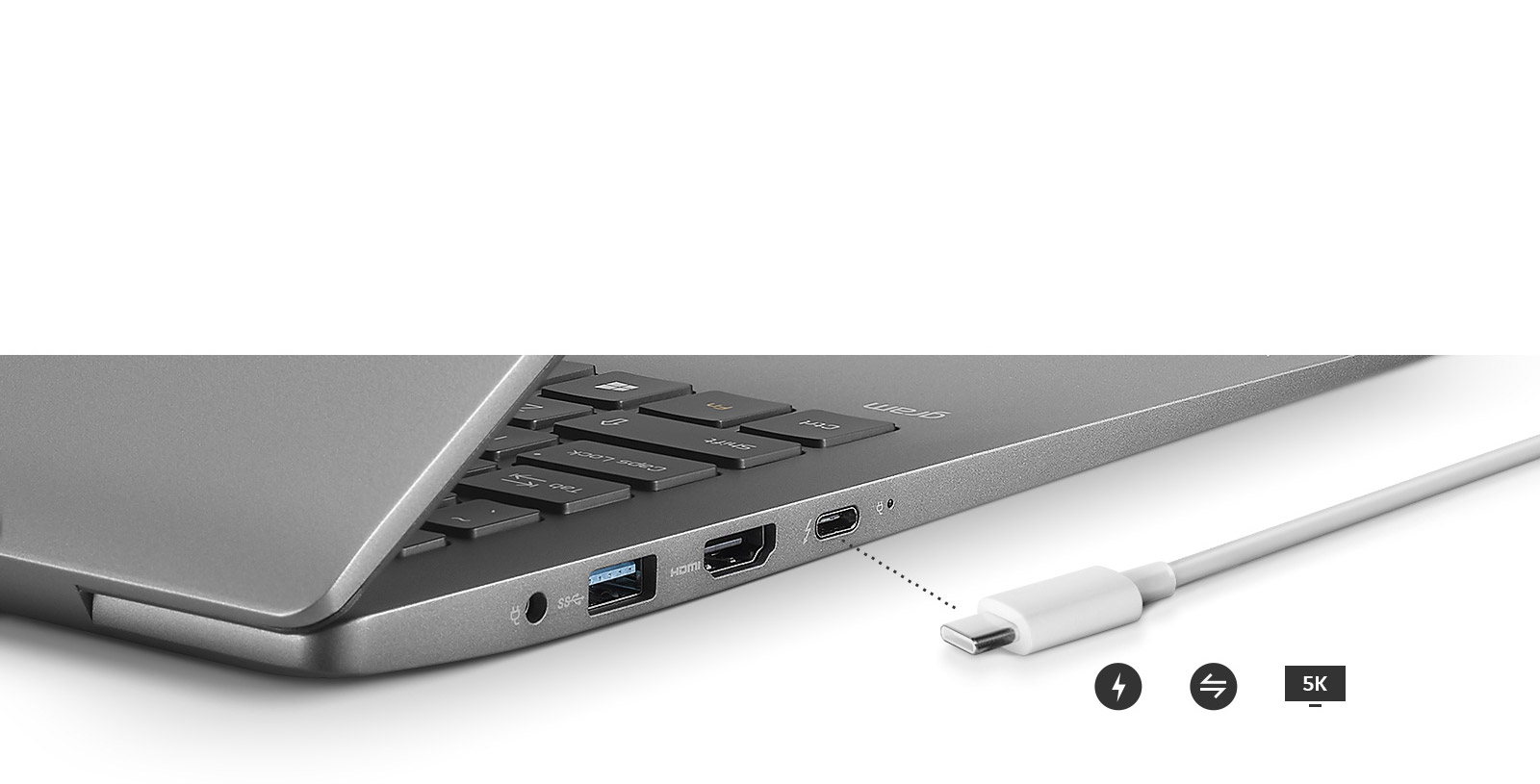 Image of a side view of the laptop with close up of outputs and a charger