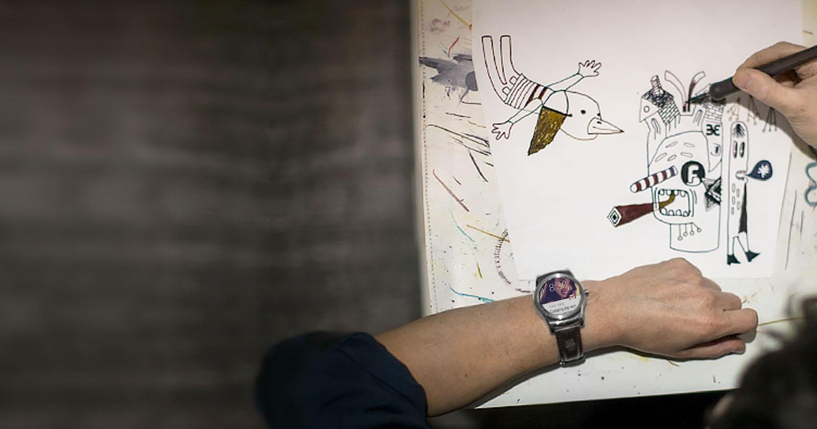 Image of person drawing while simultaneously using the LG Watch Urbane Gold
