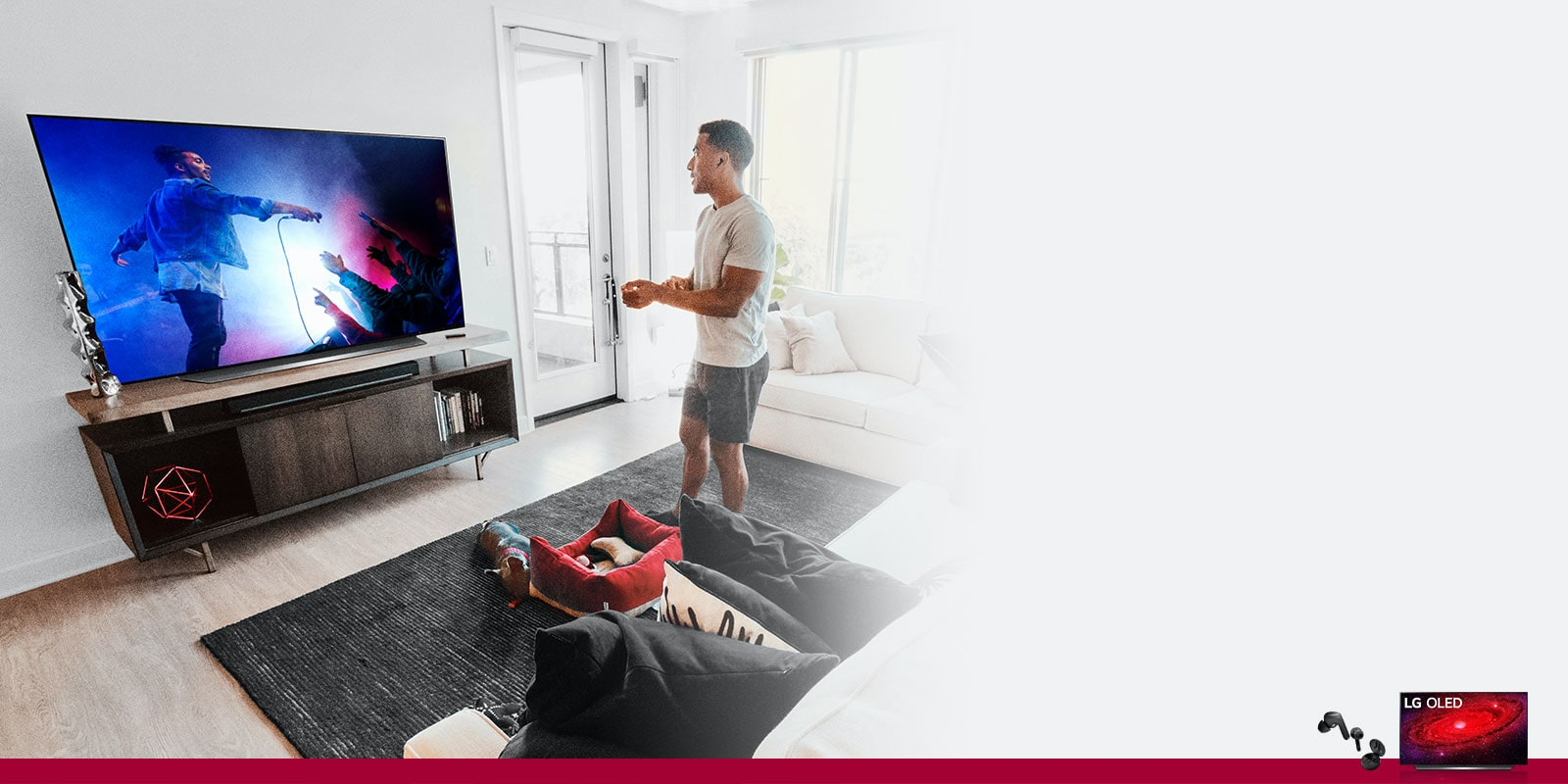 man with his dog watching tv in a living room