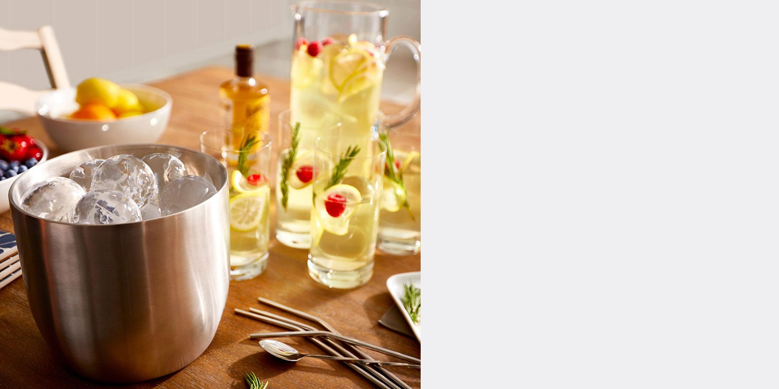 Styled Craft Ice in a bucket next to a lemonade pitcher and glasses