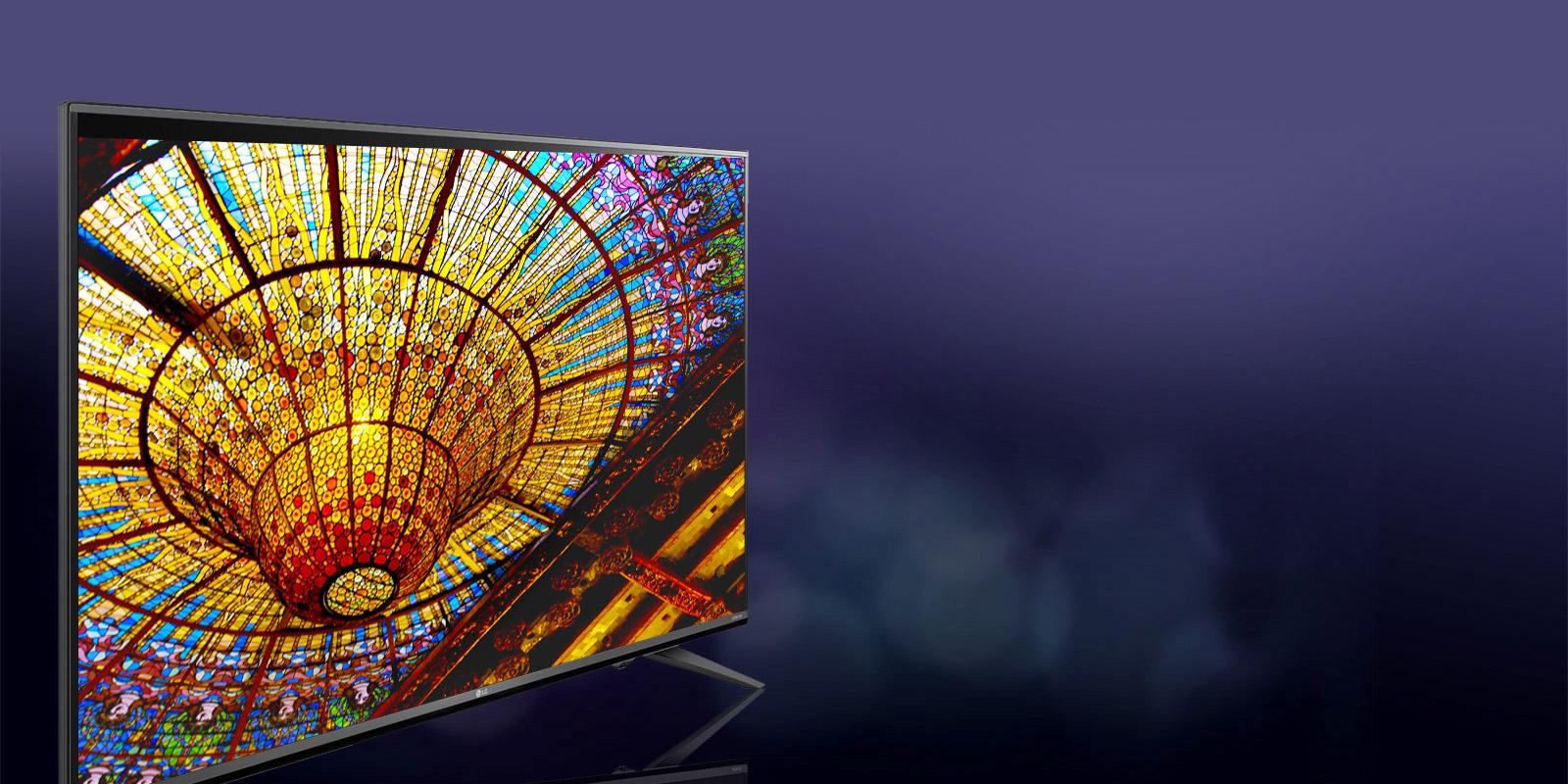 LG TV with the image of a stained glass ceiling on the screen.