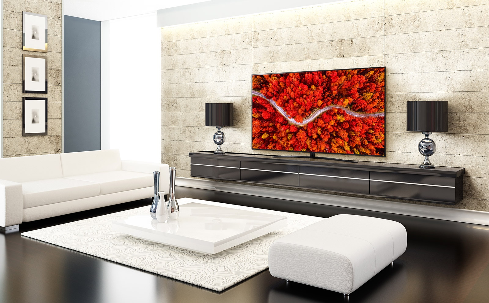 A luxury living room with a TV displaying an aerial view of woods in red.