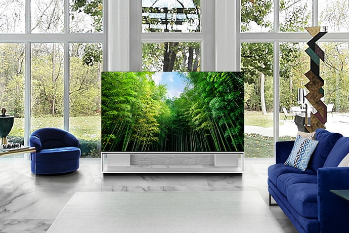 LG SIGNATURE OLED 8K TV is placed on the center of living room, which is decorated by the color of classic blue and white marble.