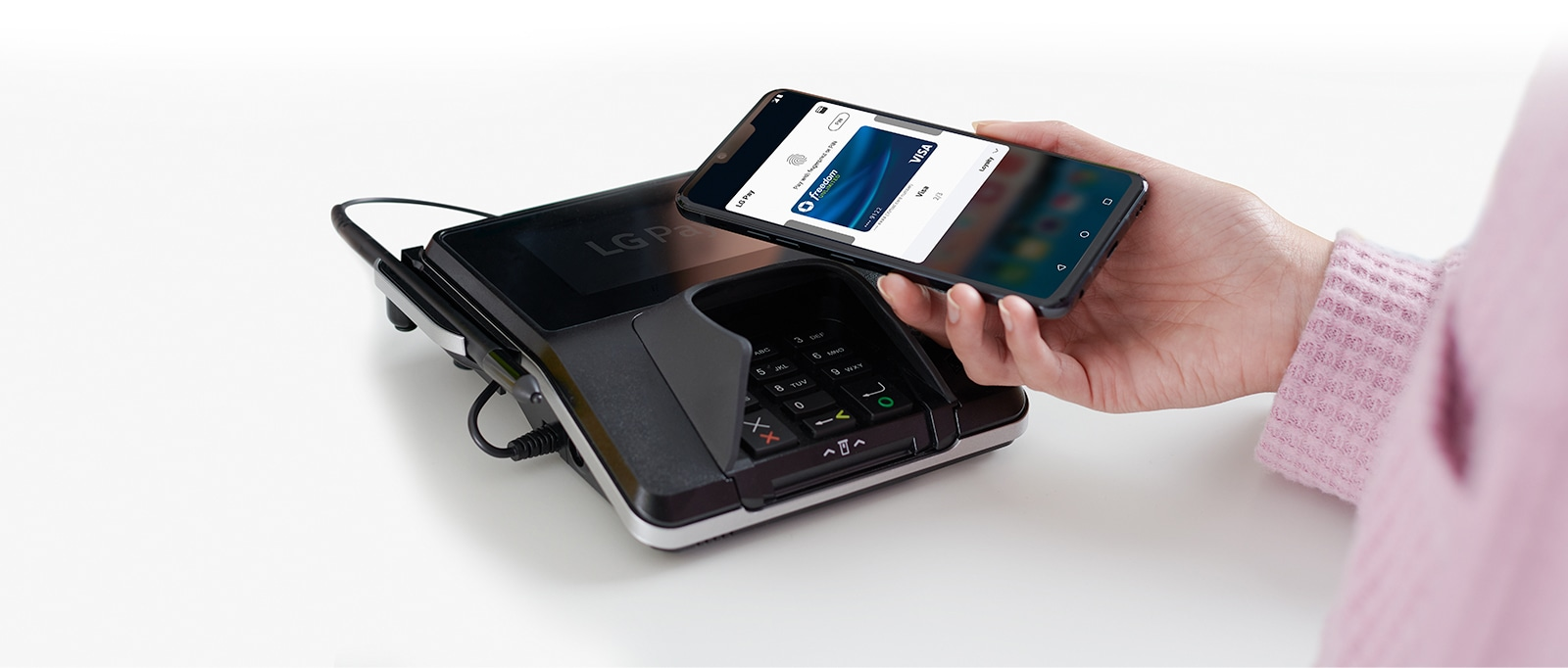 Image of someone using LG Pay.