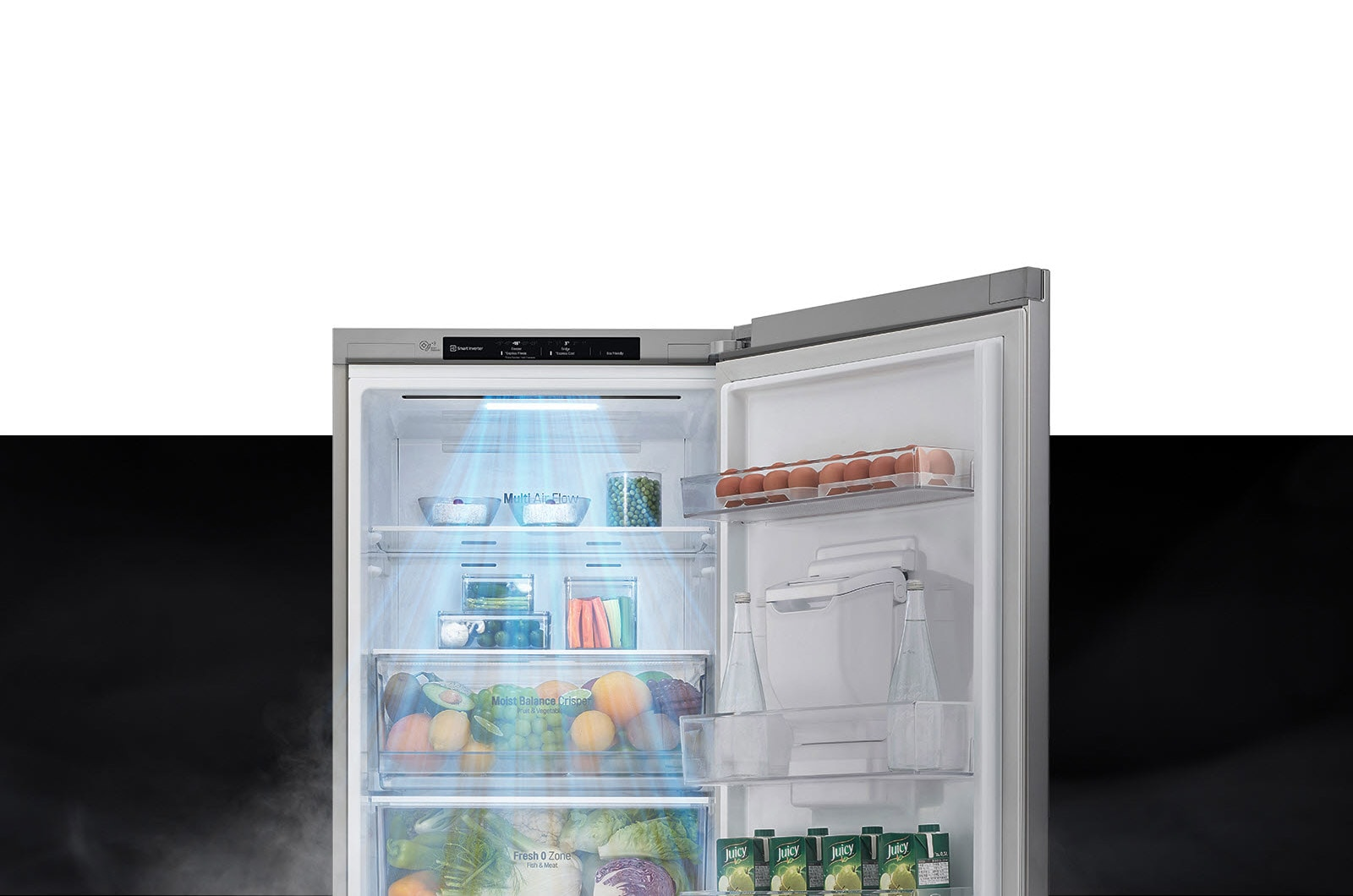 The top half of the refrigerator is shown with the door open. Inside, the shelves are filled with produce and drinks and a gust of wind comes down from the top to cool off the food.