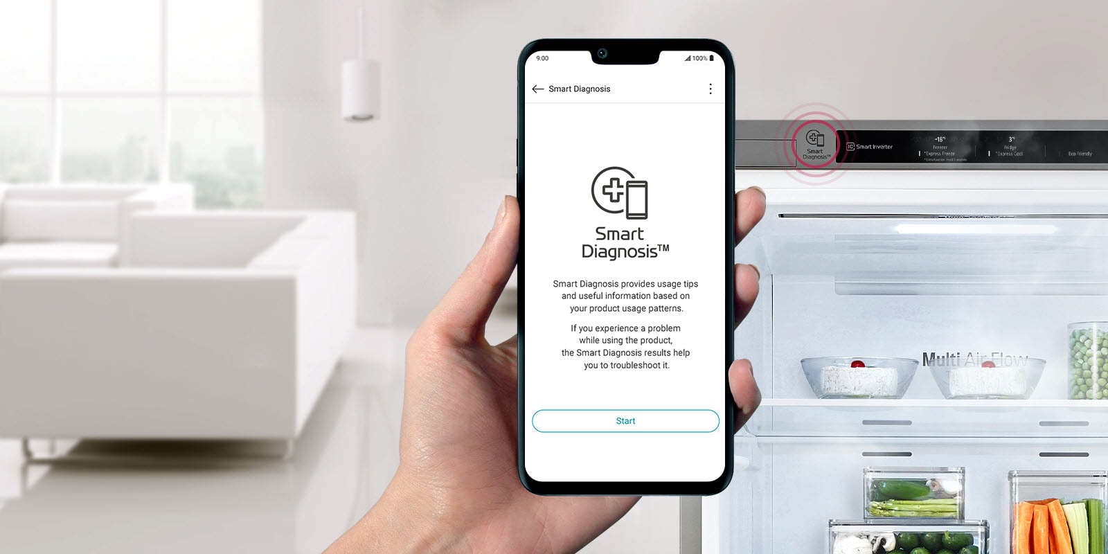 A hand holds a phone facing the front with a refrigerator in the background. The screen of the phone shows the Smart Diagnosis app for maintenance alerts.