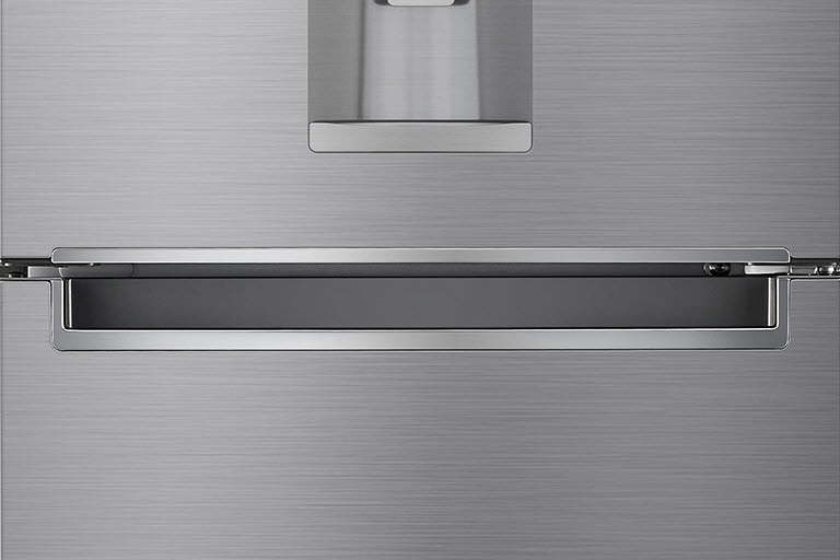 A close up photo of the center of the refrigerator showcasing the elegant and minimalistic handle.