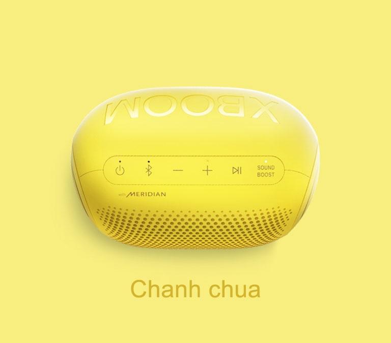 Loa LG XBOOM Go hình kẹo Jellybean vị chanh chua được đặt trên nền vàng.
