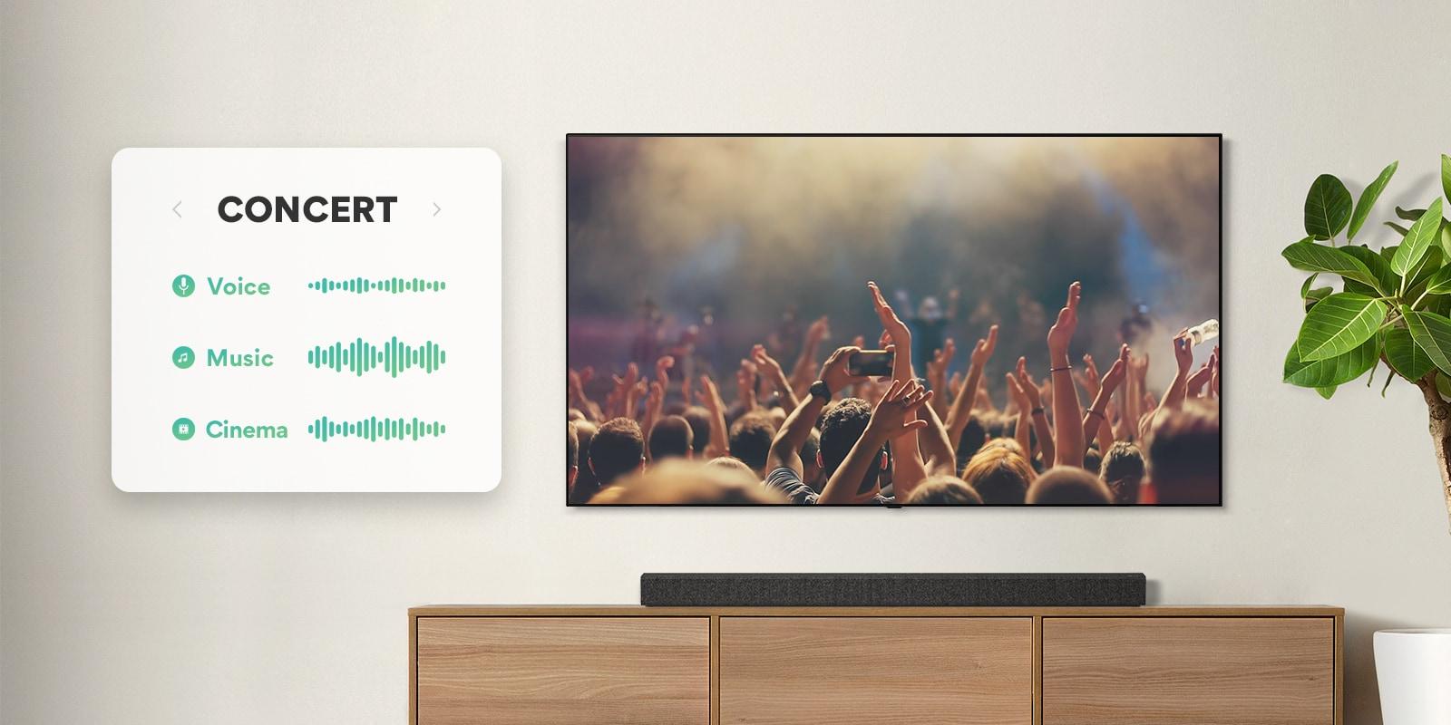 TV treo trên tường. TV thể hiện mọi người đang vỗ tay tại buổi hòa nhạc, kênh được chuyển sang cảnh phim với một chiếc xe đang chạy trong rừng, và kênh một lần nữa được chuyển sang Tin tức và một người dẫn chương trình đang nói. LG Soundbar nằm ngay bên dưới TV trên kệ màu be. (phát video)