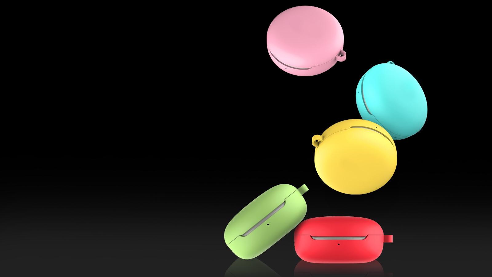 Hình ảnh năm chiếc hộp tai nghe LG TONE Free FN4 trong năm vỏ có màu khác nhau trôi xuống sàn nhà bóng loáng