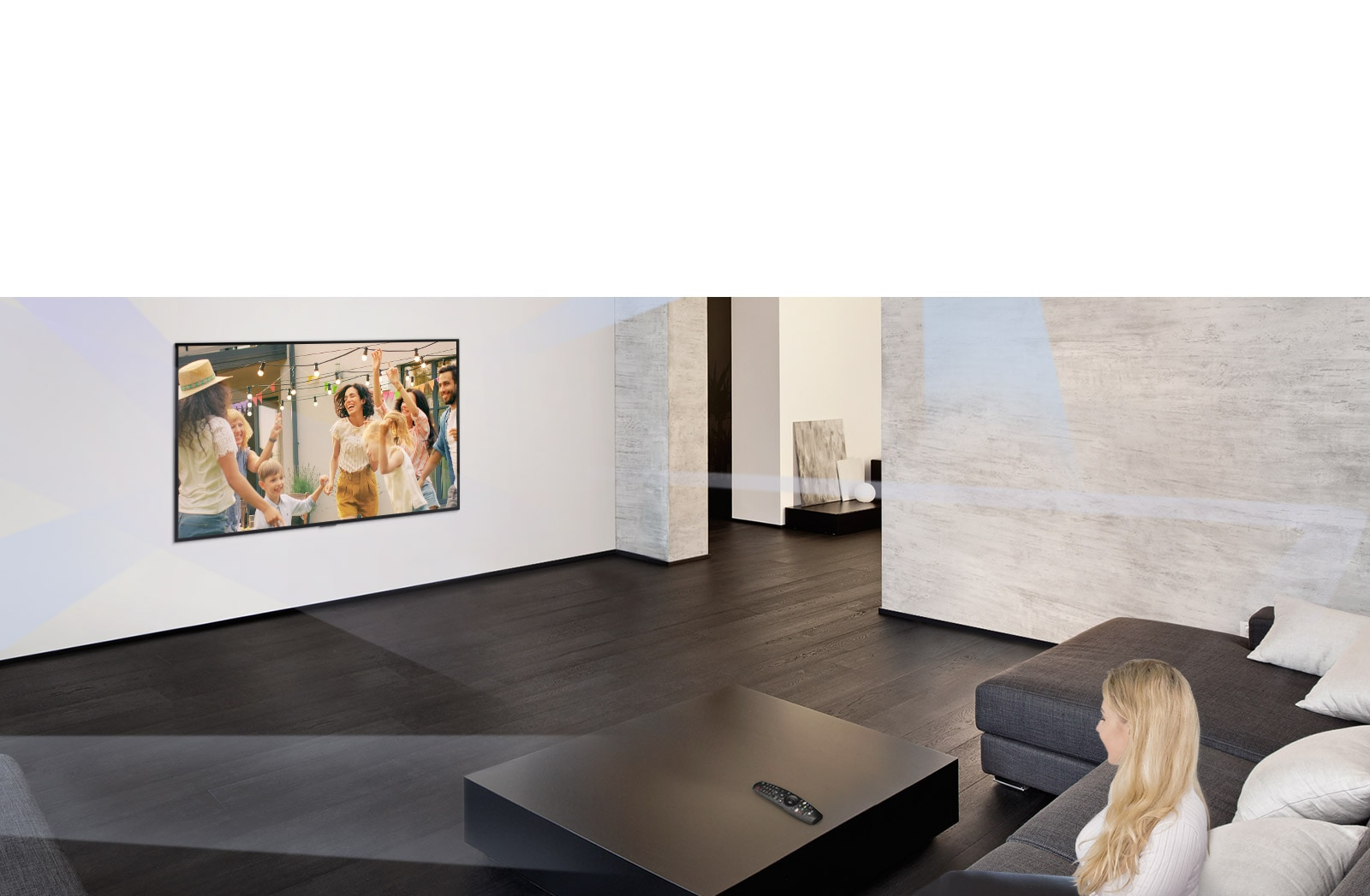 Woman in large and minimalistic living room watching people dancing on TV